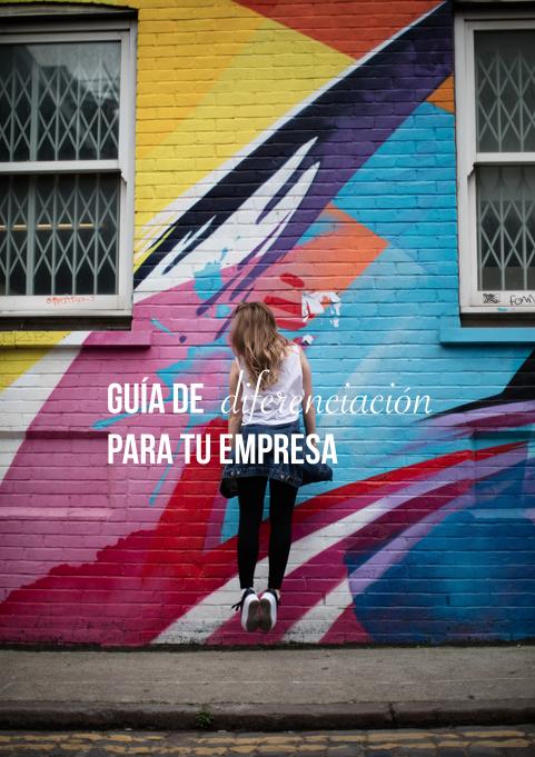 chica saltando frente a graffitis